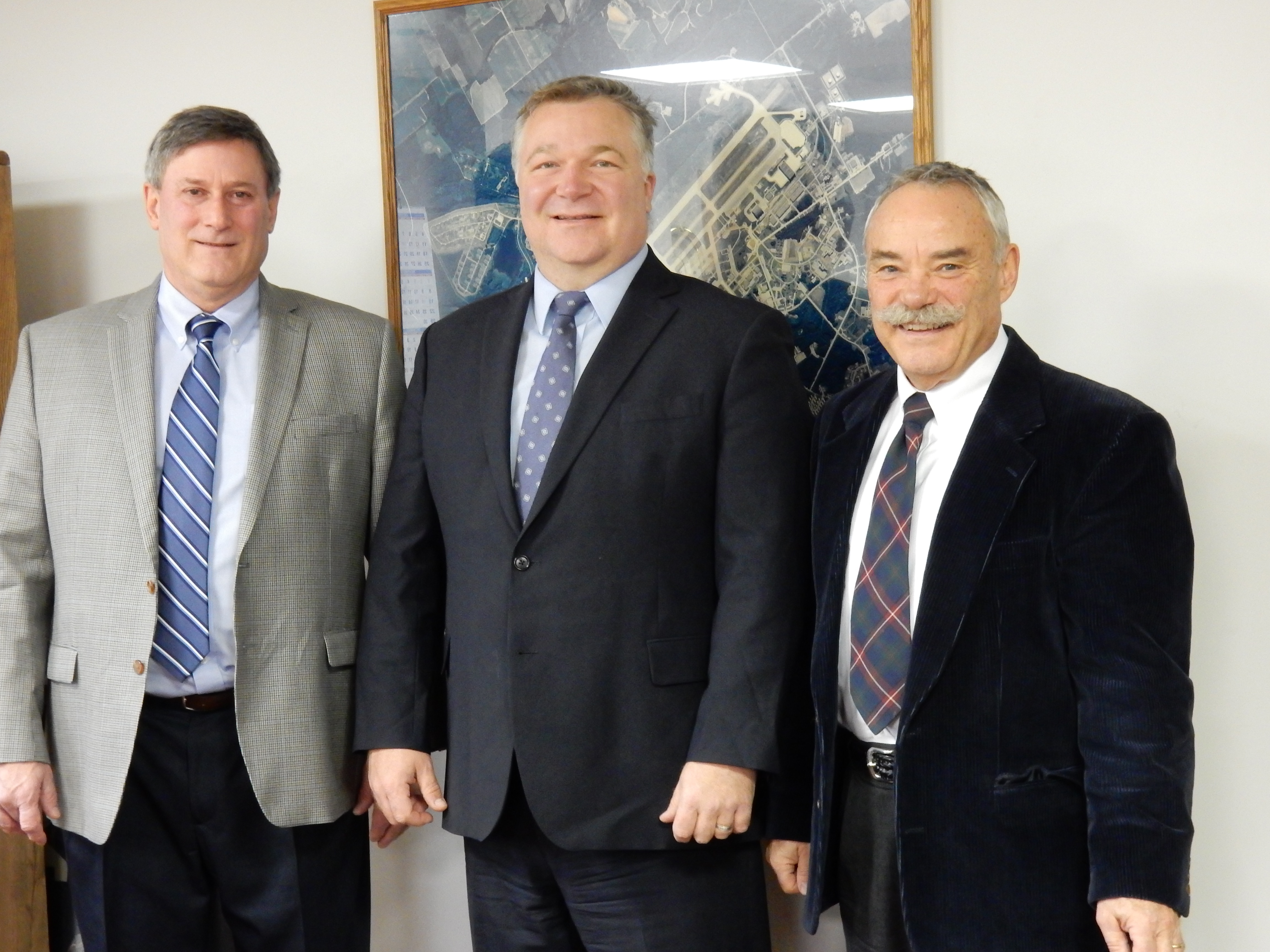 Loring Commerce Center President & CEO Carl Flora, NBRC Federal Co-Chair Mark Scarano, and Alain Ouellette from Northern Maine Development Corporation.